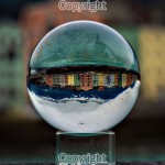 Jonathan Ford - Colourful Innsbruck River House through a Crystal Ball - Sony A58 with 50mm